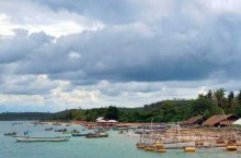 local fishermen and small huts in ekas bay